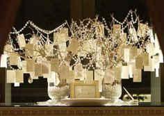 Get a 'Wish Tree' instead of a guest book. Guests write a wish for the bride and groom and hang it on the tree! Pretty too :)