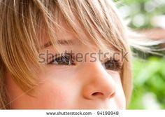 little boy looks away - stock photo