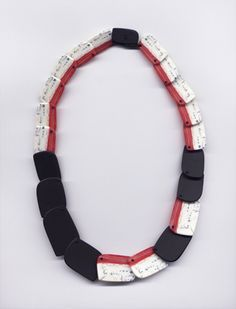 "Erica Rosenfeld - ""Red, Black, and White Carved Necklace,"" fused glass"