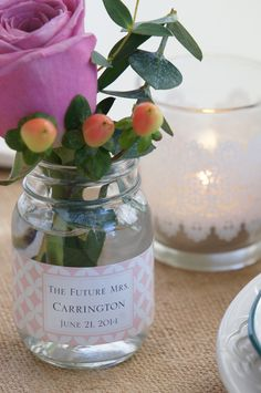 Lace printed glass votives and mini mason jars from Kate Aspen set a sweet glow on the table at a vintage floral bridal shower