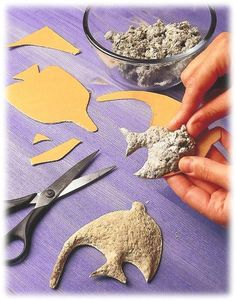 Cut shapes from cardboard then top with paper pulp. Allow to dry for 2-3 days. Paper mache, dry then paint