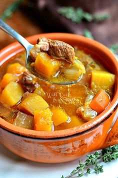 Slow Cooker Winter Squash Beef Stew _ Winter is still hitting most of us with some chilly weather so I have just the dinner to serve to warm your tummy and your soul. Slow Cooker Winter Squash Beef Stew is a comforting, homemade stew made with lots of vegetables, including butternut and acorn squash.