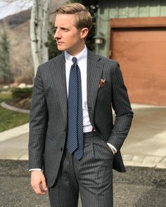 Mr. Derek Bleazard Grey stripe flannel suit. White tab collar shirt. Patten puff pocketsquare. Navy circle tie.