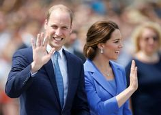 Prince William and Kate Middleton wave to waiting members of the public during their visit to the German city on July 19th, 2017.