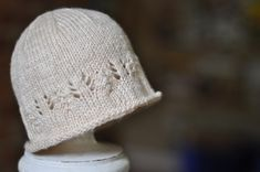 Ravelry: Simple newborn hat with a touch of lace pattern by Ginny Sheller