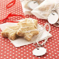 For smaller cookie gifts or holiday party take-homes, carefully place a layer of our festive Glazed Bizcochito Stars in waxed-paper or cellophane bags: http://www.bhg.com/christmas/cookies/delightful-christmas-cookie-gifts/?socsrc=bhgpin101214waxedpapercookiebags&page=5
