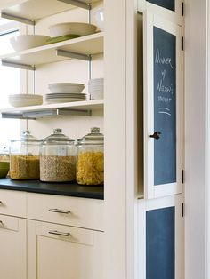 Apply chalkboard paint to cabinet panels to create a handy message board.