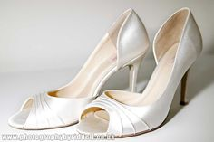 Classic and classy ivory satin wedding shoes. mix in something from www.mymixxi.com to spruce them up!
