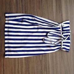 Blue & White Stripped Pencil Skirt Sz Small Blue & White Stripped Pencil Skirt Sz Small. 100% silk. Back zipper closure. Wrap around belt. 24 inches long. Brand new. Never been worn.  Visit our women's travel blog!  www.dametraveler.com   Instagram: @dametraveler  Twitter: @dametraveler  Pinterest: /dametraveler  Facebook: /dametraveler No brand Skirts Pencil