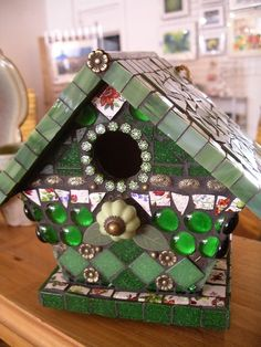mosaic birdhouse- This is beautiful.  I love the different tiles and glass and findings.  Good inspiration for my project.
