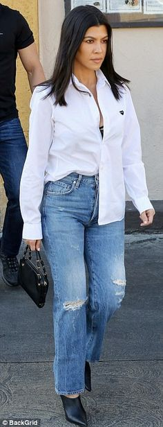 Leggy lady: Her gorgeous gams were highlighted in a pair of ripped faded denim pants as they cut high above the ankle