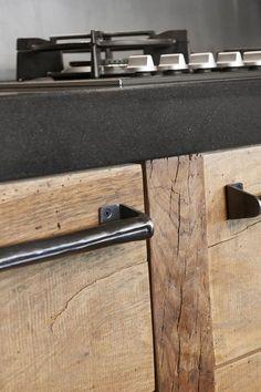 Raw wood, steel pulls on cabinets