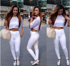 White highwaisted jeans, striped white top, pink/purple lips