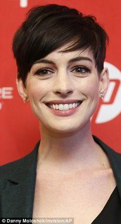 Anne Hathaway wears green trouser suit for Sundance premiere of ...