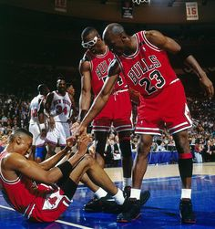 74f4d4e9fb5 Michael Jordan and Horace Grant helped up Scottie Pippen in Game 6 of the  Eastern Conference