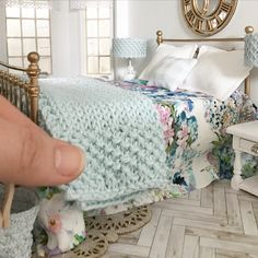 miniature dolls Same bed, different throws. swipe to see some beautiful hand knitted throw blankets available in store