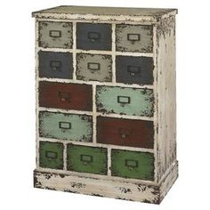 Thirteen-drawer weathered wood and metal cabinet.   Product: CabinetConstruction Material: Metal and wood Color: Weathered white and multiFeatures:  Industrial charmAdds character and interest to any space13 Drawers provide ample storage space Dimensions: 32 H x 24 W x 13.75 D