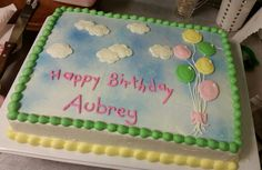 Birthday cake for 1 year old with balloons.