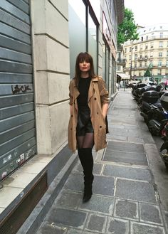 8400c1c215d698 Wearing thigh high boots with a classic style trench will always afford you  a modern and classy style. Kristina Bazan is rocking the look