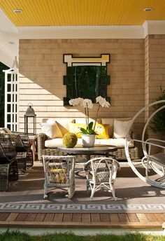 Pretty Porches and Terraces   Traditional Home - I personally LOVE doing this: Add depth to an outdoor space with a mirror.