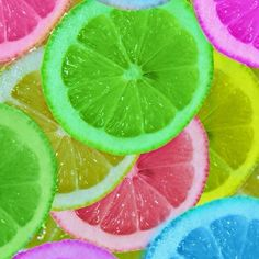 Let oranges or lemons soak in food coloring Freeze and you could put them in a super cute punch. Cute idea for a party or just a hot summer day.
