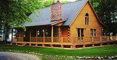 Out of a movie! Southern Wrap Around Porch on this Log Home (the Madison) for just 75K.