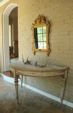 A beautiful pair of 19th c. French demi lune console tables in original, hand-scraped paint. Available on our website.