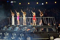 The Spice Girls perform on top of cars as they drove around during The London 2012 Olympic Closing Ceremony at the Olympic Stadium August 12, 2012.