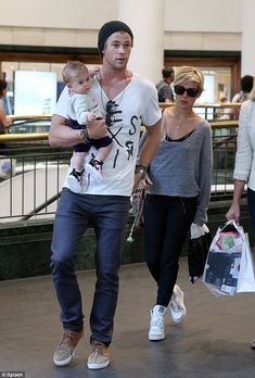 Let's go shopping: Shortly after landing in Sydney, Chris took India and Elsa shopping