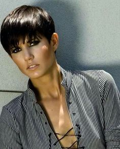 Short back with long bangs. Pixie cut.