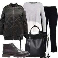 Outfit morbido e modaiolo, jeans scuri, illuminati dalla maglia bicolore, bomber lungo, scarponcini traforati e borsa dalle forme inusuali. Semplice ma con pezzi di gran moda.