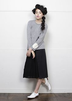 Grey sweater / black midi skirt / white shoes