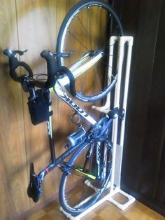 Vertical storage solution built from PVC pipe (low Pvc Bike Racks, Diy Bike Rack, Bike Hanger, Bike Storage Rack, Bicycle Rack, Diy Storage, Storage Ideas, Pvc Pipe Storage, Garage Storage