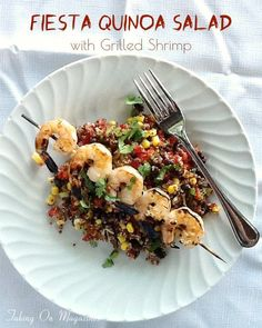 Fiesta Quinoa Salad with Grilled Shrimp | www.takingonmagazines | This colorful Fiesta Quinoa Salad has a bright vinaigrette that pairs perfectly with the grilled shrimp served along with it.