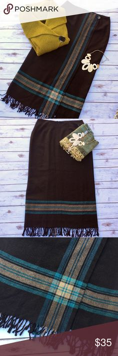 Awesome Maxi Mock Wraparound Fringed Blanket Skirt Wonderful dark brown winter time skirt with accents of curry and teal, fully lined, mock button closure on the left, zipper in back. Size 10, made in U.S.A. Measures 15 inches across at the waist and about 36 inches in length including the fringes. Michele Skirts Maxi