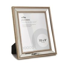 Inject a touch of elegance into your space with this gorgeous frame with a  mirrored and beaded design. With a 10 x 8 inch (25 x 20cm) space for the image of your choice, this frame will create the perfect feature anywhere in your home. Able to stand or hang both landscape and portrait.  For a real stylish impact, mix with co-ordinating frames on a feature wall and create a collage of your favourite memories.<BR><BR>Fixings  not included. Always read instructions.