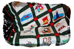 A throw quilt by Barbara Griffin, made with fifteen Newfoundland heritage images. Scenes are painted with permanent fabric markers on white poly cotton fabric and framed with Newfoundland tartan plaid. Full view can be seen on my craft website.