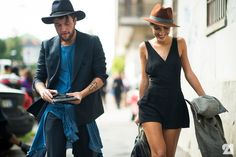 Man and woman wearing hats