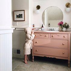 Repurpose a vintage dresser into a vanity.