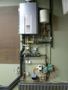 How to Heat a Garage Exploring some low-cost options for keeping an attached garage comfortable for both people and vegetables (free article after free registration) Garage Heater, Heated Garage, Plan Garage, Hydronic Heating, Hydronic Radiant Floor Heating, Building A Shed, Garage Design, Garage Workshop, Garage Storage