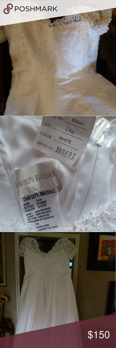 Wedding dress Size 24W New, never worn. Paid $600 from David's bridal in South Tampa. Must go, make offer. Smoke free home David's Bridal Dresses Wedding