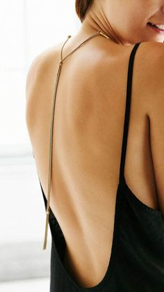 lariat necklace, love the low back dress