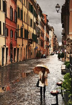 Street in Rome...  with a street lined with climbing vines and a romantic color palate, a blanket of gray sky seems less daunting... Italy is calling!