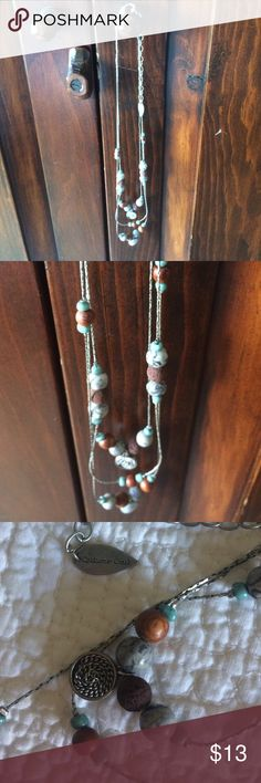 """🌸Coldwater Creek Necklace Coldwater Creek Necklace with adjustable chain. Necklace can hang as long as 12"""" & as short as 11"""". It has three silver tone chains with various beads of blue, brown, gray, & silver. 🌞 Coldwater Creek Jewelry Necklaces"""