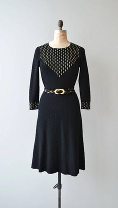 Vintage 1930s black soft boucle knit dress with metallic gold threaded detail at the bodice, repeated detail on the cuffs and belt. Metal zipper at the back of the collar. --- M E A S U R E M E N T S ---  fits like: small/medium shoulder: 15 bust: 32-36 waist: 26-28 hip: 38 length: 42