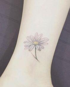 cool Daisy ankle tattoo by Tattooist Flower...