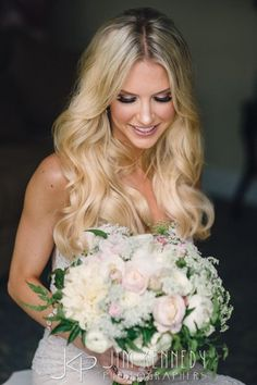 Beautiful blonde bride at this Ritz Carlton Wedding | bride with long hair down | wedding hair wedding makeup | Jim Kennedy Photographers
