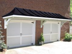 Pictures of Hip Roof Pergola over Garage Doors from Atlanta Decking and Fence Company