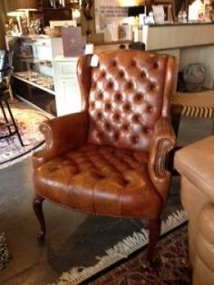 Minneapolis: Brown leather tuffed accent chair $225 -