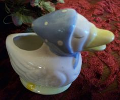 """Cute white duck figurine  Hand painted ceramic  White duck with yellow bill wearing a light blue scarf  Could be used as a toothpick holder  2 1/2"""" h x 3"""" l x 1 3/4"""" w  No makers marks - has been in my personal collection since the 1980's.   A different little duck for the collector of cute Springtime and Easter decorations.  Thank you for visiting A Vintage Addiction    YS1012CV25W4SW8"""